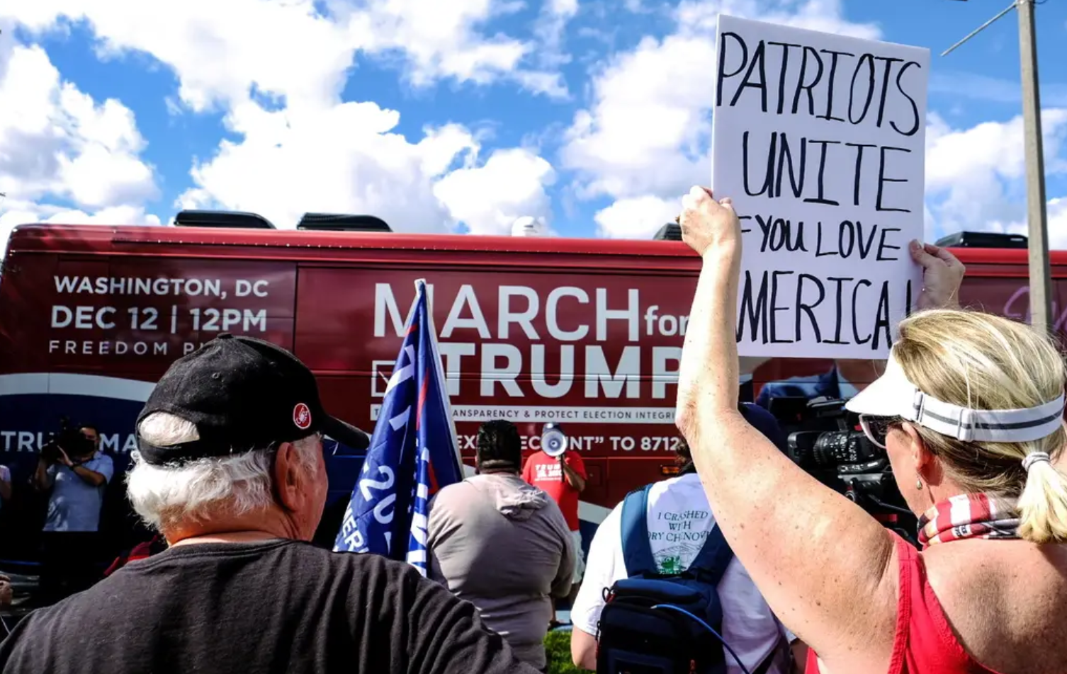 """Alt= """"March for Trump Busy with People Holding Pro-Trump Rally Signs"""""""